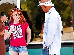 Redheaded slut rides a big black dong