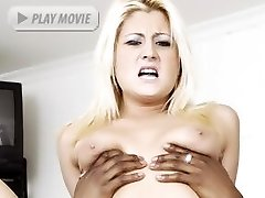 Blonde cutie Staci Thorn moans in pleasure while getting fucked hard in this racy interracial...