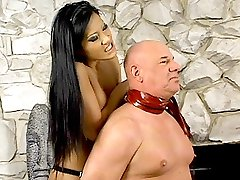 Mistress Christina Aguchi teasing a hunk with her tits before giving him a good whipping