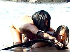 Lesbian mistress punishes her sexy slave in the water, has her suck a strapon and fucks her