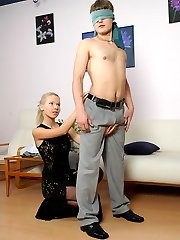 Cutie in back seam nylons greeting her blindfold boyfriend with a strap-on