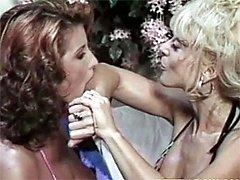 Two retro lesbians licking