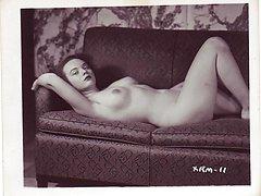 Big boobs of luscious retro gal pressed tightly