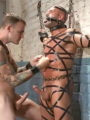 Coby Mitchell sways in ropes, hung from the racks in a meat locker. His tormentor, Christian...