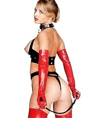 Sadistic blonde bitch in black latex and boots
