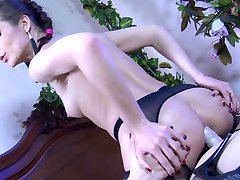 Glasses-wearing lesbo lets her girl suck a strapon cock before backdoor fun