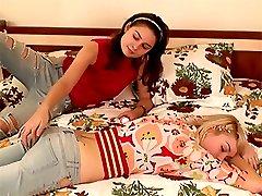 Very cute brunette teen girl tastes her friends tight pussy