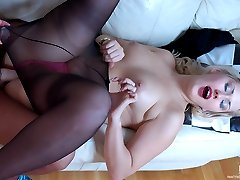 Horny lez babe in black pantyhose talks her roommate into a strap-on fuck