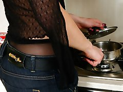 Downtrousers gal in black pantyhose pulls down her denim doing nasty things