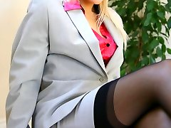 Cute secretary wearing skirt suit, satin top and sexy lingerie.