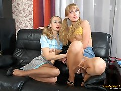 Nasty babes eagerly pulling up skirts to savour frantic nylon games on sofa