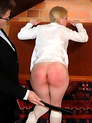 Bare arsed blonde schoolgirl bends over for the belt