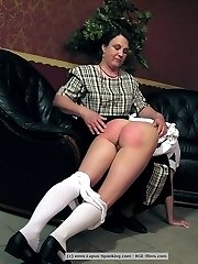 The wooden paddle on 2 girls bare bottom