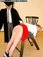 Two school girls in uniform spanked and caned over the bench