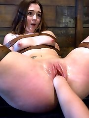 Savannah West is a pretty girl who likes trying new things. She gets a girl-on-girl BDSM...