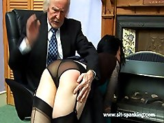 Hot brunette in stockings bent over the table and caned hard on her large sexy ass