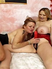 Two kinky mature lesbians with huge boobs share oral jobs before strapon fucking