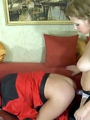 Smoking babe attacks a handyman and plunders his rear with a strap-on rod