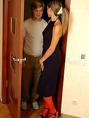 Strap-on armed hottie giving a fucking-from-behind lesson to curious guy