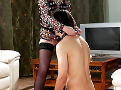 Dominative mistress spreads a guys cheeks aiming a strapon up his backdoor