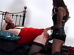 Strapon Jane puts this curvy TGirl in a cage and teases her