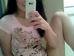 Cutie brunette amateur charmer Kitty Lix showing ass and pussy on the couch