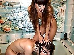 Femdom mistress sinking slave in the bath