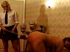 Watch how red her supervisor leaves her after a hard bare handed spanking and leather paddling....