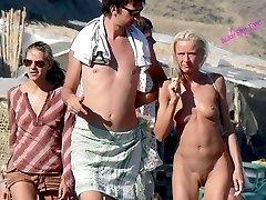 Voyeur camera at nude beach - video and photos