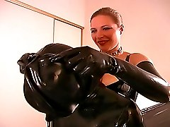 Blond dominatrix in black latex preparing her slave for a lonf femdom session