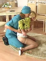Filthy doctor lowering babes silky pantyhose to examine her sweet holes