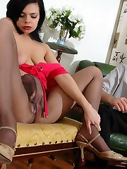 Passionate brunette babe teasing horny dude with her pantyhose clad booty
