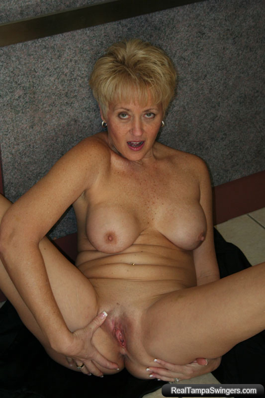Blonde swinger wife Tracy bares it all in a public elevator