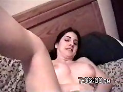 hot babe filmed playing on the bed