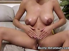 Busty amateur Gia strips showing her hairy pussy