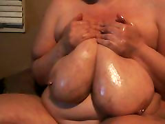 Juicy oiling her big gorgeous tits for all her fans