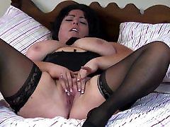 Big busty mom rubs her clit