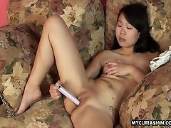 Asian sweet cheeks slut toying her wet pussy