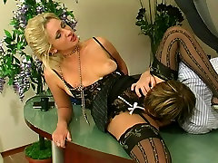 Secretary in sexy stockings uses dildo and a man