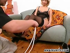Amateur Milf toys and strokes a dick with cum on tits