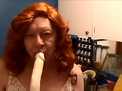Naughty Gigi deep throating double dildos