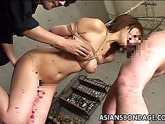 Asian slut has a cock to suck as she&039;s tied up