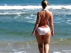 Hot thick blonde girl. Bikini beach.