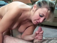 Mature swinger Liisa shows her big tits while sucking dick
