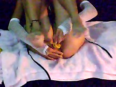 Skinny fit jap woman inserts bananas in both holes