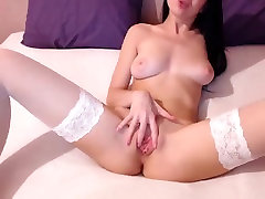 Charming young brunette in white seachads orgy seductively