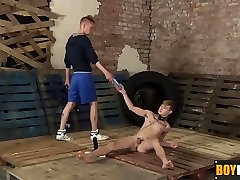 Slave toy Skyler toying with his ass and loving a huge dildo