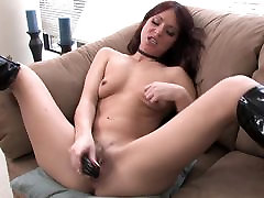 Skinny MILF in kinky boots uses two toys on her pussy