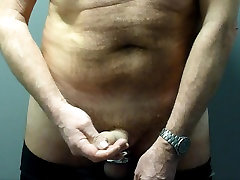 Daddy cums in new black nylon panties in swimming pool stall