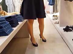 Following shiny tan pantyhose girl in night
